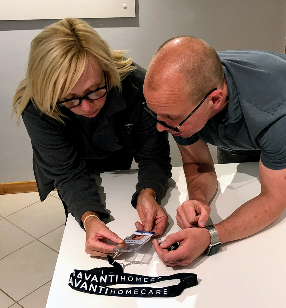 Photograph of Jo and Taras in an office discussing the design of the Avanti ID card