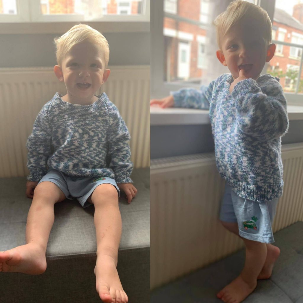 A member of our team's son wearing a jumper that was made by one of our clients